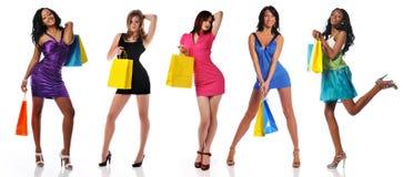påsar som shoppar kvinnor Arkivfoto