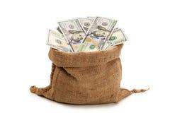 Påse av kassa, nya 100 dollarräkningar Arkivfoton