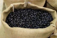 Påse av svarta bönor Arkivbilder