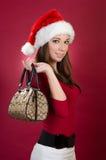 Påse för Santa kvinnaholding royaltyfria bilder