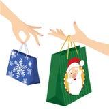 Påse för shopping för jul för kvinnahand hållande stock illustrationer