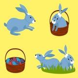 Påskägg i korgen och kaninerna royaltyfri fotografi