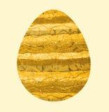 Påskägg med gult tyg Arkivfoto