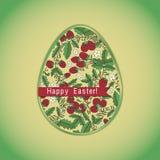 Påskägg med jordgubben, grönt hälsningkort Fotografering för Bildbyråer