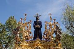 Påsk i staden av Seville, Jesús Cautivo Arkivfoto
