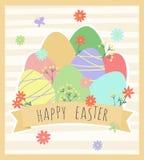 Påskhälsningskort med ägg och blommor Arkivfoto