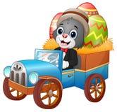 Påskkanin som kör en bil som bär easter ägg vektor illustrationer