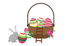 Påskkaninkanin med påskkorgen mycket av dekorerade påskägg Royaltyfri Fotografi