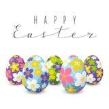 Påskkort med blom- dekorerade ägg Arkivfoto