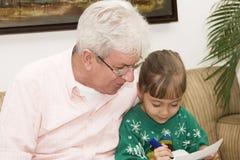 Père appréciant avec sa petite-fille Photo libre de droits