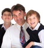 Père avec des fils Photographie stock