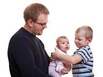 Père avec le fils et la chéri Photos stock