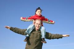 Père de mouche avec le fils Photographie stock