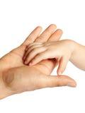Père donnant la main à un enfant Photographie stock libre de droits