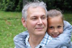 Père et descendant gais Photo stock