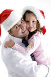 Père et descendant mignon avec le chapeau de Noël Image stock