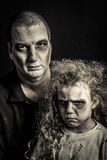 Père et fille de zombi Photo stock