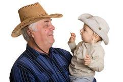 Père et fils dans un chapeau de cowboy. Photo stock