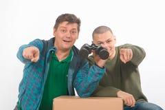 Père et fils des homosexuels Verticale dans le studio sur le blanc Photos libres de droits