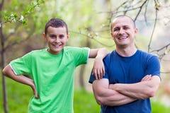 Père et fils heureux Photographie stock