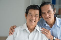 Père et fils heureux Image stock