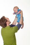Père jouant avec le bébé garçon heureux Photographie stock