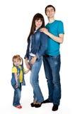 Père, mère et jeune descendant dans des jeans Image stock