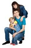 Père, mère et jeune descendant dans des jeans Photos stock