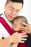 Père tenant un bébé image libre de droits