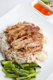 Pé da carne de porco com arroz no fundo branco Fotos de Stock