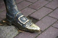 Pé na estátua da sapata. Imagens de Stock