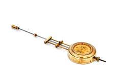 Péndulo de cobre amarillo del reloj viejo Imagenes de archivo