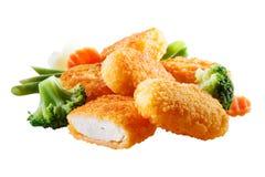 Pépites avec des légumes. Avec le chemin ?lipping photographie stock libre de droits