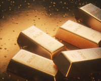 Pépites d'or d'exploitation Image stock