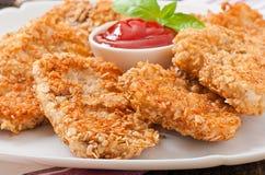 Pépites de poulet Photos libres de droits