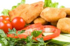 Pépites de poulet avec des légumes Image libre de droits
