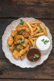 Pépites de poulet et pommes frites Image libre de droits