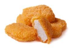 Pépites de poulet sur le fond blanc Image libre de droits