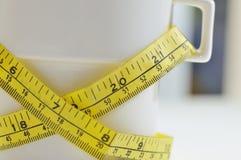 Pérdida de peso en una taza I imagen de archivo