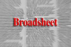 Périódico escrito en rojo con un artículo periodístico borroso en th Fotos de archivo libres de regalías