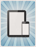 Périphériques mobiles sur le rétro fond Photographie stock libre de droits