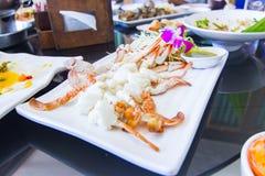 Pés de caranguejo cozinhados com molho de marisco picante Fotos de Stock Royalty Free