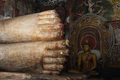 Pés de colocar a Buda Imagens de Stock