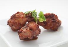 Pés de frango frito com folhas do aipo Foto de Stock Royalty Free