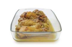 Pés de galinha cozidos na placa de vidro isolada no fundo branco Imagem de Stock Royalty Free
