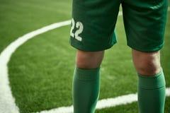 Pés de Thq do jogador de futebol do futebol Fotografia de Stock Royalty Free