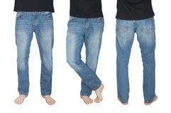 Pés dos homens nas calças de brim em poses diferentes Imagem de Stock Royalty Free