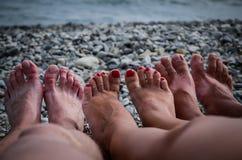 Pés e a praia Fotografia de Stock Royalty Free