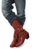 Pés em botas de vaqueiro Imagem de Stock