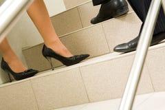 Pés em escadas Imagens de Stock Royalty Free